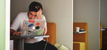 frustrated on laptop