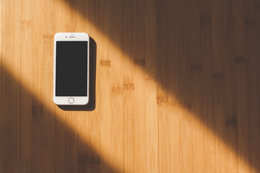 White iPhone on Wood Table