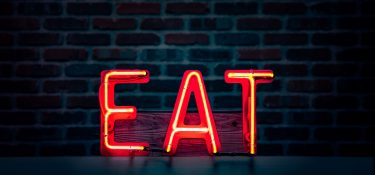 Glowing red EAT sign